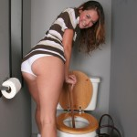 Allie Haze Jerks Off Big Cock Sticking Out of a Gloryhole 05