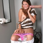 Allie Haze Jerks Off Big Cock Sticking Out of a Gloryhole 15